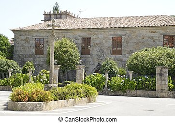 Cross stone in plaza in Cambados - Cross stone in front of a...