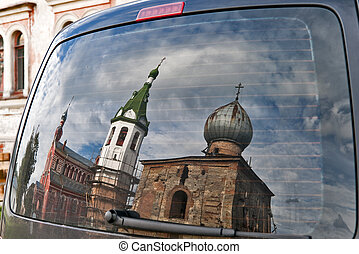 Car back window reflection of monastery buildings