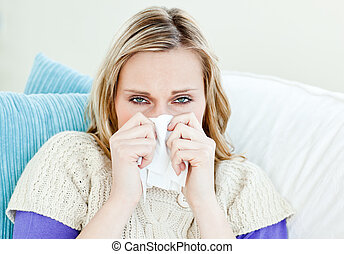 sick woman with tissues at home