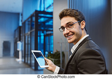 Back view of Smiling Business man with laptop computer -...