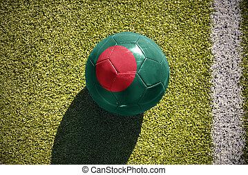football ball with the national flag of bangladesh lies on...
