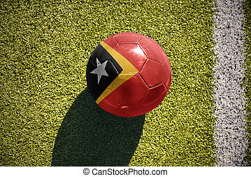 football ball with the national flag of east timor lies on...