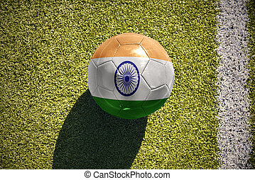 football ball with the national flag of india lies on the...