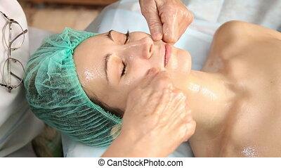 Woman doing facial massage