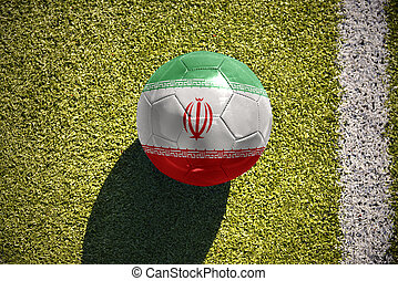 football ball with the national flag of iran lies on the...