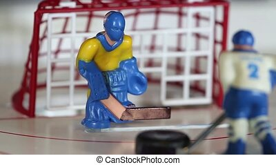 goalkeeper in ice hockey - ice hockey table game macro shot