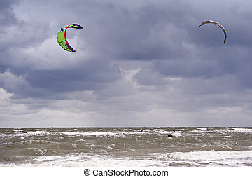 Kitesurfing - Kitesurfer on the beach of St Peter-Ording,...