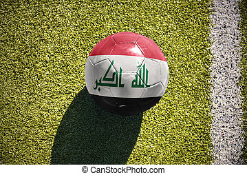 football ball with the national flag of iraq lies on the...