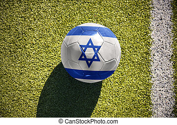 football ball with the national flag of israel lies on the...