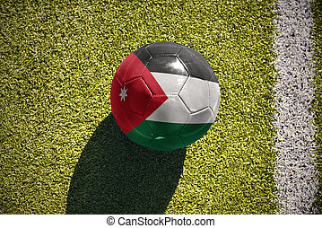 football ball with the national flag of jordan lies on the...