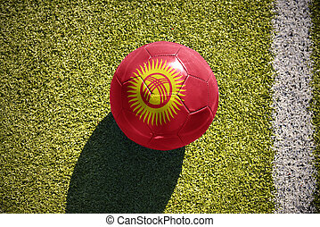 football ball with the national flag of kyrgyzstan lies on...