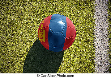 football ball with the national flag of mongolia lies on the...
