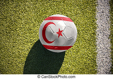 football ball with the national flag of northern cyprus lies...
