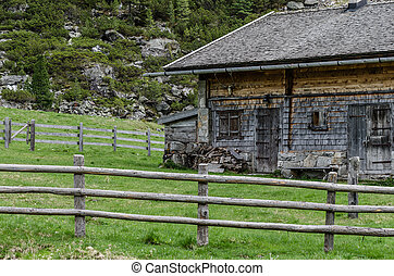 house in the mountains with fence