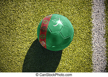 football ball with the national flag of turkmenistan lies on...