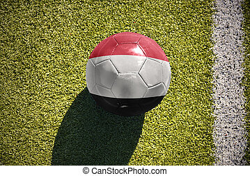 football ball with the national flag of yemen lies on the...