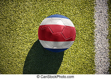 football ball with the national flag of costa rica lies on...