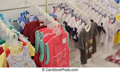 Children clothes hanging at the shop - Children clothes...