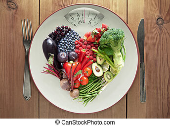 Diet concept heart shape fruit and vegetables - Plate with...