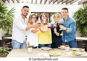 Friends making a toast with wine