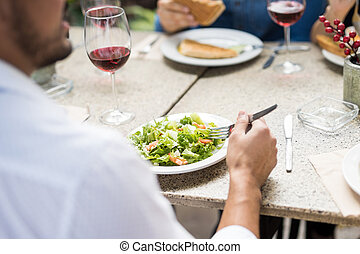 POV of man eating a salad - Closeup of a young man eating a...