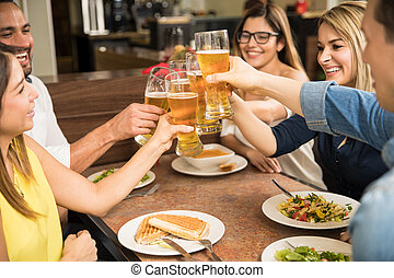 Group of friends drinking beer - Closeup of a group of young...