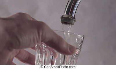 Running water from a water tap, in slow motion, HD