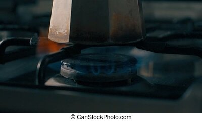 Slow motion clip of a stove burner,