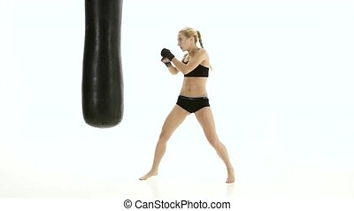 Training punching bag was beaten cute girl boxer. White...