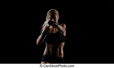 Direct blows on the camera of a girl boxer, young blond...