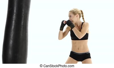 Boxer girl takes out all the emotions on punching bag,...