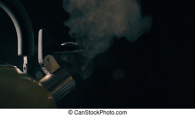 Steaming tea kettle, dark background HD