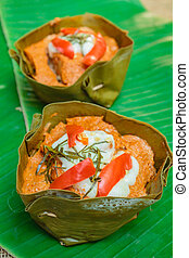 Steamed fish with curry paste. - Steamed fish with curry...