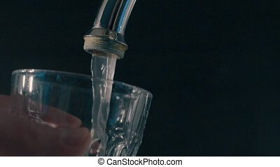 Running water from a water tap, in slow motion