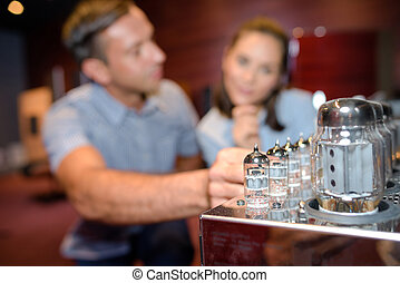 Blurred couple behind glass objects