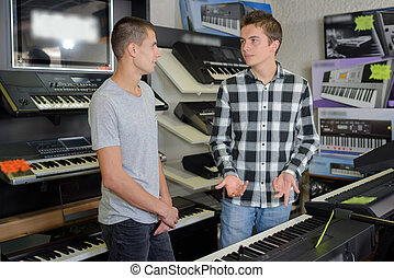 Young men looking at keyboards