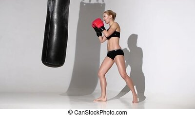 Knockout for the punching bag of the beautiful girl boxer.