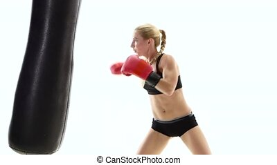 Strong girl boxing champion fulfills blows on the punching...