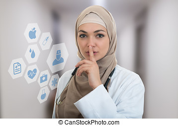 Closeup portrait of friendly, confident muslim with hijab...