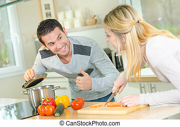 Couple cooking a meal