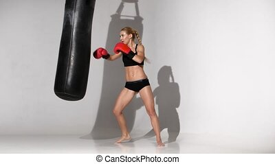 Girl boxer finished the training with a punching bag, makes...