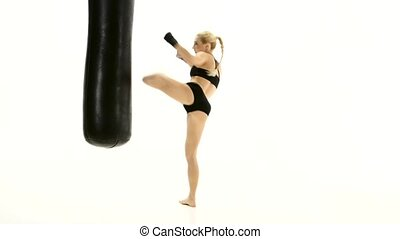 Intensive training with a punching bag girl boxer. White...