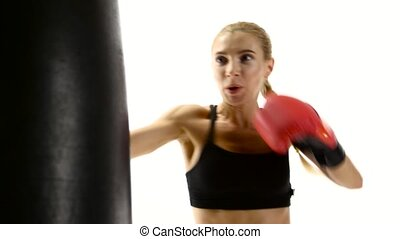 Woman boxer takes out aggression on the punching bag,...