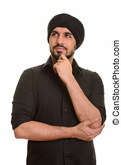 Young handsome Indian Sikh thinking