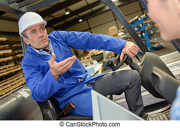 Man in forklift questioning lady