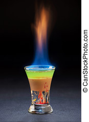 burning alcoholic cocktail. - glass of alcoholic cocktail in...