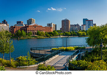 View of the Charles River and buildings in Boston, at North Point Park, in Cambridge, Massachusetts.