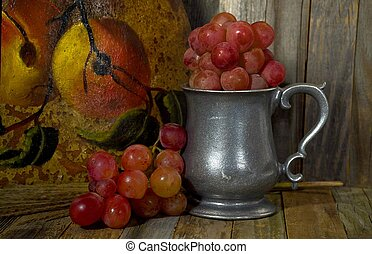 red grapes in pewter pitcher - red grapes in old-fashioned...