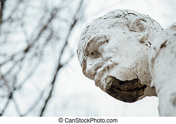 Damaged Lenin statue, peeling vintage paint. The concept of...