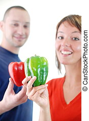 happy couple with peppers isolated - happy couple with...